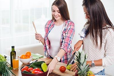 Women slicing vegetables